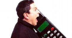 Dom Joly with his giant mobile phone