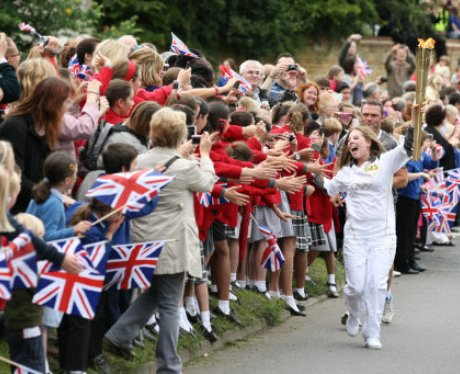 Excited crowd at Buckingham Olympic Torch Relay