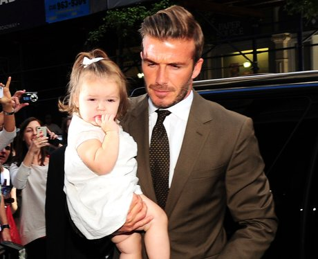 David Beckham carries Harper in New York