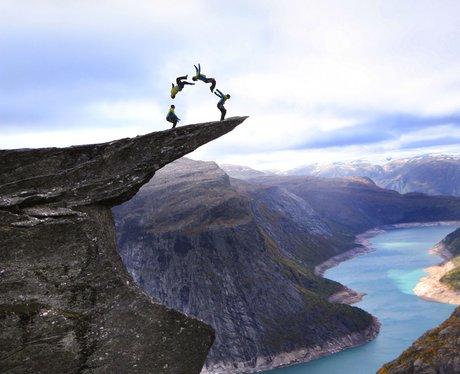 Daredevils Perform Stunts At Troll's Tongue Norway