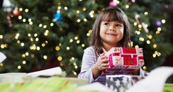 Christmas Child With Present Commerical
