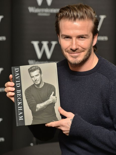 david beckham posing with his autobiography