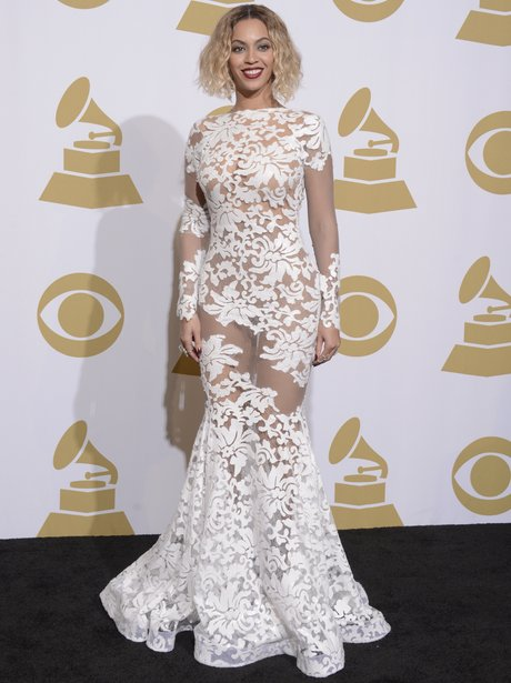 Beyonce backstage at the Grammy Awards in a white lace dress