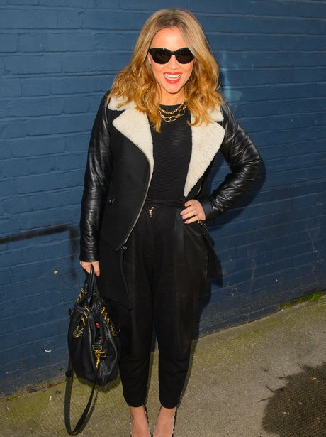 Kimberley Walsh in a black leather and fur jacket