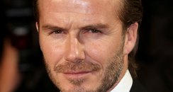 David Beckham wears a red ribbon