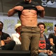 Stephen Amell torso shows torso at Comic Con