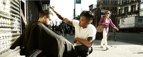 Mark cutting a homeless man's hair