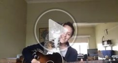 Cat and woman playing guitar