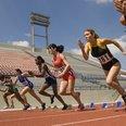 women running on running track