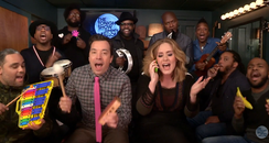Adele sining with kids toys