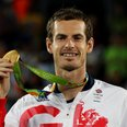 Andy Murray poses with his gold medal in Rio