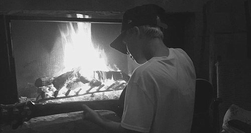 Cruz Beckham playing guitar by the fire