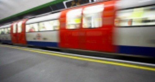 tube train going through station